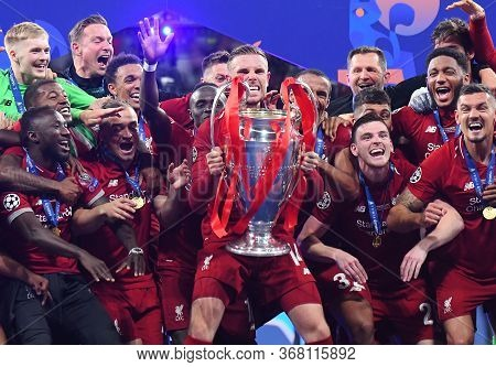 Madrid, Spain - June 1, 2019: Jordan Henderson Of Liverpool Lifts The Trophy During The Award Ceremo