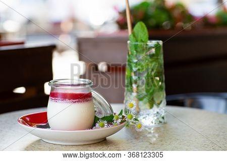Vanilla Panna Cotta With Jelly Of Berries In Glass Jar. Italian Dessert Panna Cotta. Classic Italian