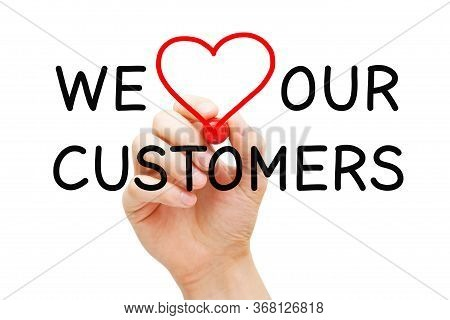 Hand Writing We Love Our Customers With Marker On Transparent Wipe Board. Customer Satisfaction, App