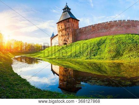 Veliky Novgorod Kremlin - Savior Tower Reflecting In The Water Moat In Veliky Novgorod, Russia, Trav