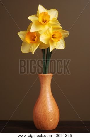 Daffodils In Wooden Vase Vertical