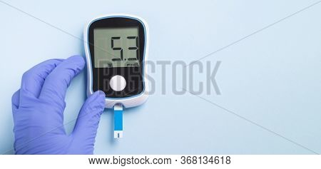 Doctor`s Hand Holding Glucose Meter. Measures The Level Of Glucose In The Blood For Diabetics. Diabe