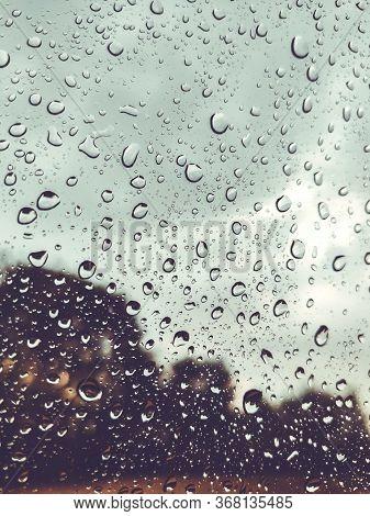 Raindrops On The Cars Glass Window. Raindrops On The Transparent Window, On The Glass. Weather, Rain