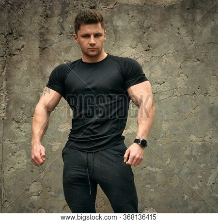 Attractive Athletic Portrait Of A Guy In A Sports T-shirt. Beautiful Portrait Of A Fitness Model. Th