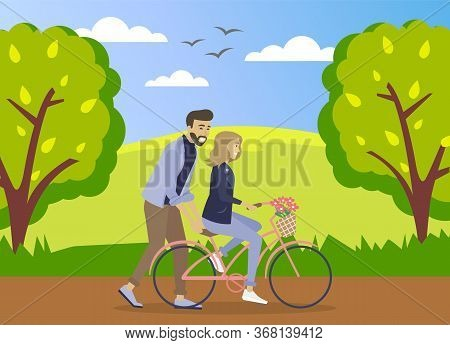 Happy Young Man Is Helping A Smiling Woman To Ride A Bicycle On The Road At Summer Forest Background