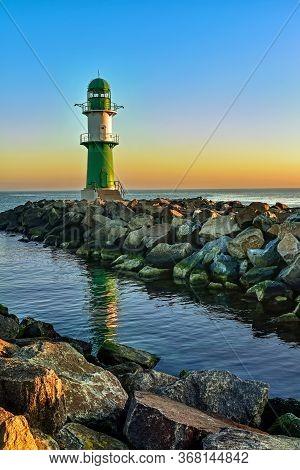 Lighthouse On The Western Pier In Warnemünde In Germany