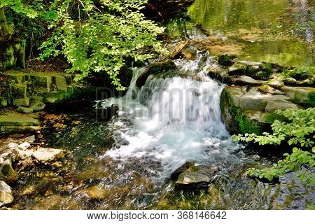 Weir On The Watercourse Of The River Mohelnice, Below Lysá Hora, A Forest Stream In The Village Of K