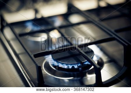 Kitchen Modern Gas Cooker With Burning Fire Propane Gas. Gas Stove. Blue Flames On Gas Stove Burner