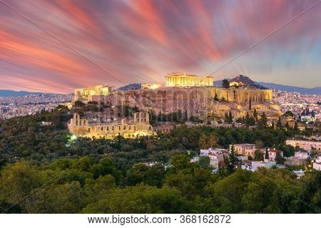 The Acropolis of Athens, Greece, with the Parthenon Temple with lights during sunset. Athens, Greece, Europe