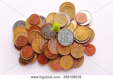 Stack Of Euro Cent Coins On A White Background. Hryvnia Coin Is Black And White Color. Hryvnia Is Ou