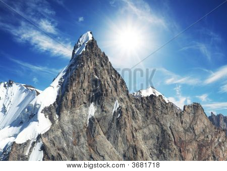 Sun And Snow In Mountain