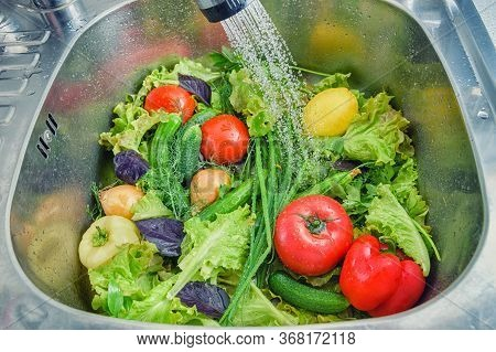 Wash Vegetables Before Eating, Very Good For Health. A Group Of Vegetables In The Kitchen Sink Close