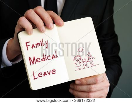 Financial Concept Meaning Family Medical Leave With Sign On The Sheet.