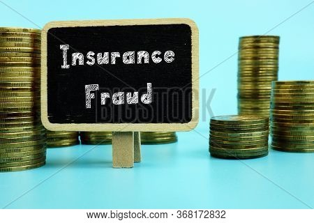 Financial Concept Meaning Insurance Fraud With Sign On The Piece Of Paper.