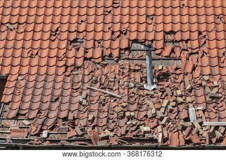 Storm Damage To A Tiled Roof, Destroyed Roof Tiles, Ceramic Roof Tiles
