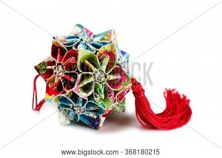 Origami Japan traditiona art in the shape of a ball - Kusudama isolated on white
