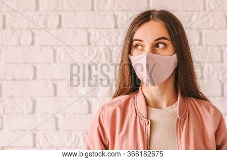 Portrait Happy Young Woman In Trendy Medical Face Mask Look At Copy Space. Beautiful Stylish Hipster