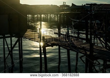 Mabul Island, Sabah, Malaysia - August 08, 2018: The Beautiful Sunlight With A Golden Color At The F