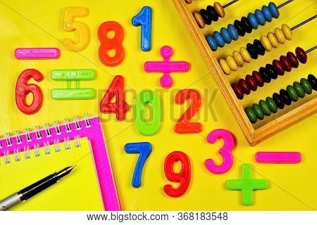 Learning To Count. Mathematical Calculations At School In The Classroom. The Numbers And The Abacus