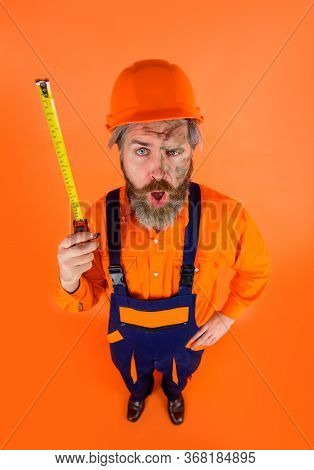 Builder With Tape Measure. Construction Worker With Roulette. Worker Use Tape Measure. Builder Equip