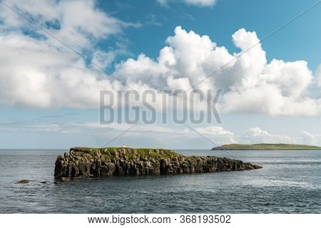 Summer view of small islands on outskirts of Torshavn city, capital of Faroe Islands, Streymoy island, Denmark. Landscape photography