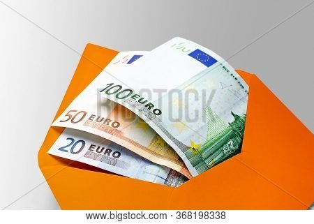 Financial Aid: 20, 50, 100, And 500 Euro Banknotes In Yellow Envelope
