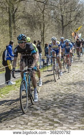 Wallers,france - April 12,2015: The British Cyclist Andrew Fenn Of Team Sky Riding In The Peloton On