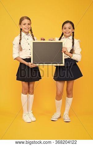 Little But Smart. Little Schoolchildren Holding Blackboard On Yellow Background. Little Children Wit