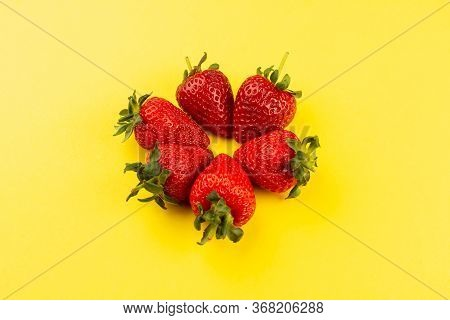 A Top View Strawberries Red Fresh Mellow Juicy Lined On The Yellow Floor