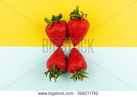 A Top View Red Strawberries Fresh Ripe Mellow On The Colored Floor