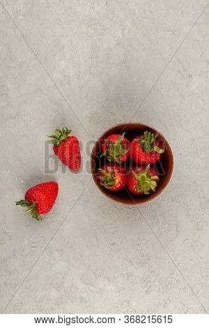 A Top View Red Strawberries Fresh Ripe Mellow Inside And Outside Brown Pot On The Light Floor