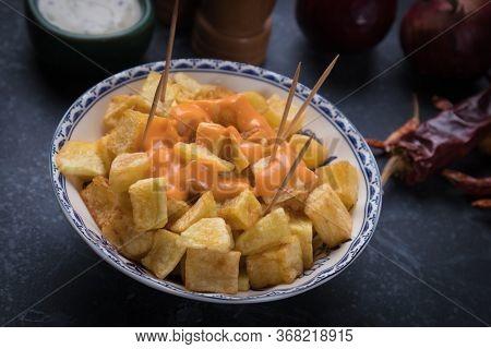 Patatas bravas, spanish fried potato as served in tapas bar