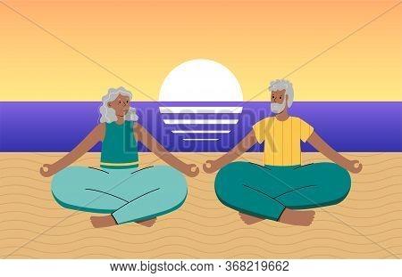 Happy Senior Couple Performs Yoga Lotus Position On The Seashore During Sunset Or Sunrise. No Stress