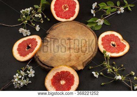 A Top View Sliced Grapefruit Mellow On The Dark Floor