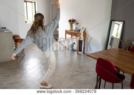 Active Young Woman Dancing At Home, Enjoying Body Movement, Going Crazy. Physical Activity At Home C