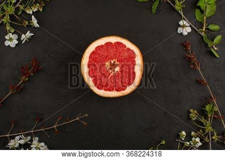 A Top View Sliced Grapefruit Fresh Mellow Juicy Ring On The Dark Background