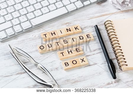 Think Outside The Box Quote With Letters On Cubes. Still Life Of Office Workspace. Flat Lay Wooden D