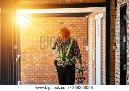 Air Conditioning Technician Male Working In The Construction Site