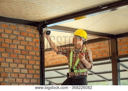 Professional Technicians Check The Ip Settings Of The Cctv System In The Building.