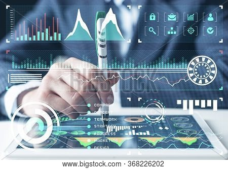 Businessman Analysis Trading Diagram At Tablet Computer. Statistical Model Prediction To Provide Ins
