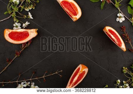 A Top View Sliced Grapefruits Fresh Ripe Mellow Juicy Isolated On The Dark Floor