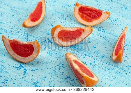 A Top View Sliced Grapefruit Juicy Mellow On The Bright Blue Background