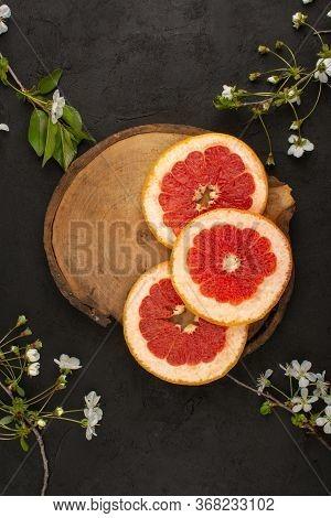 A Top View Grapefruit Rings Mellow Juicy On The Dark Floor