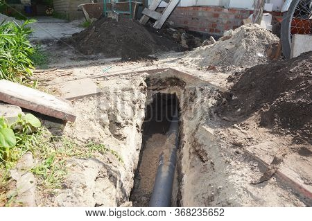 Digging A Trench For A Main Drain Pipe, Sewer Line To A Sewer Or Septic Tank. Sewer Line Replacement