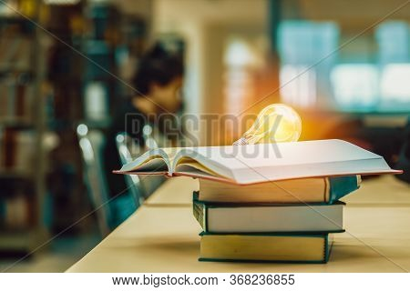 Open Book On Stack Of Books In Library At School, University, College.