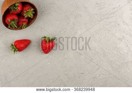 A Top View Red Strawberries Fresh Mellow Juicy On The Grey Background