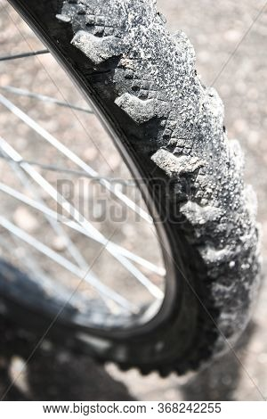 Close-up Bicycle Wheel On Road, Selective Focus, Bicycle Wheel Close Up Against The Background Of A