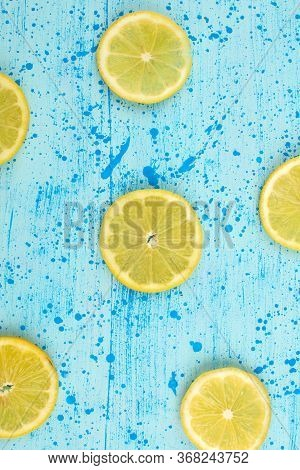 A Top View Sliced Lemon Sour Mellow Ripe On The Bright Blue Background