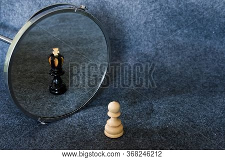 White Chess Pawn Reflected As A Black King.