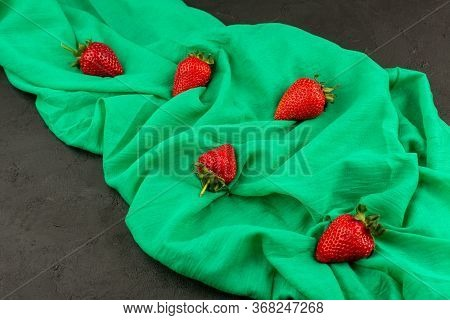 A Top View Red Strawberries Whole Isolated Mellow On The Dark Background